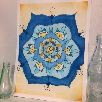 Original watercolor mandala artwork of an om (Pravana) centered around a mandala of blue flower petals and yellow decor.