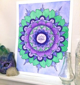 Original watercolor mandala artwork of a lotus flower centered around purple lotus flower petals and green lily pads.